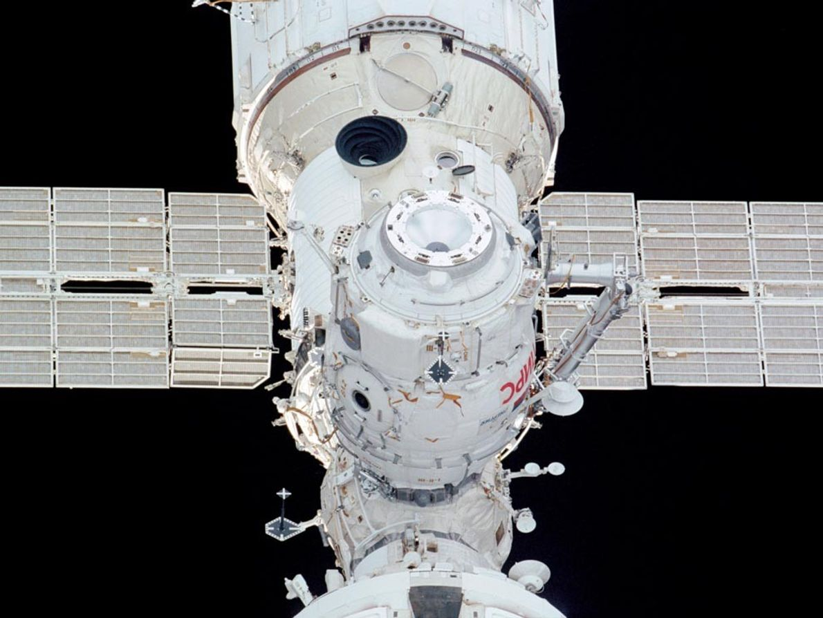 A crew member aboard the space shuttle Endeavour snapped this image of the Pirs docking compartment ...