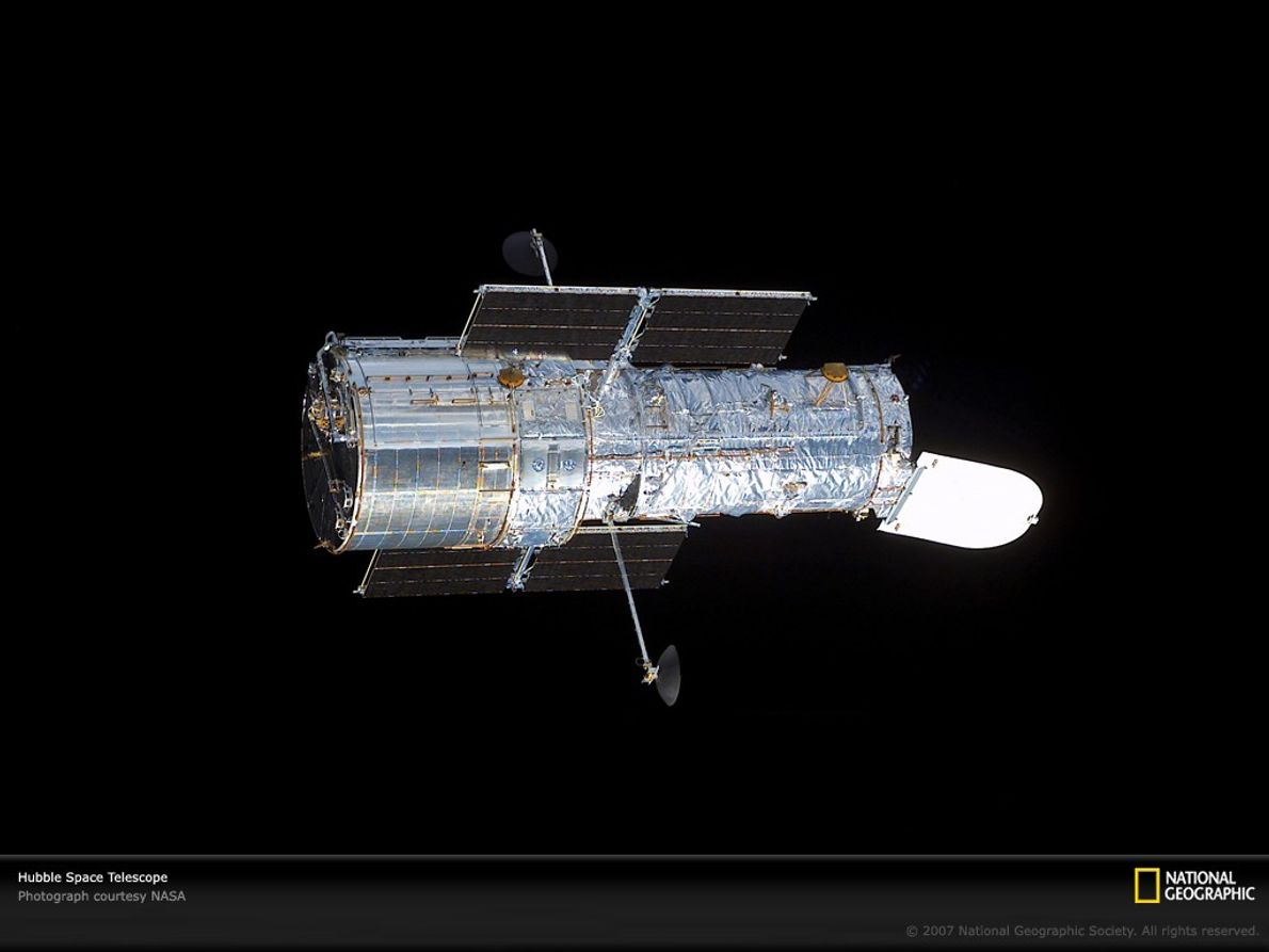 After a 2002 servicing mission, the Hubble Space Telescope sports new solar arrays on its outside ...