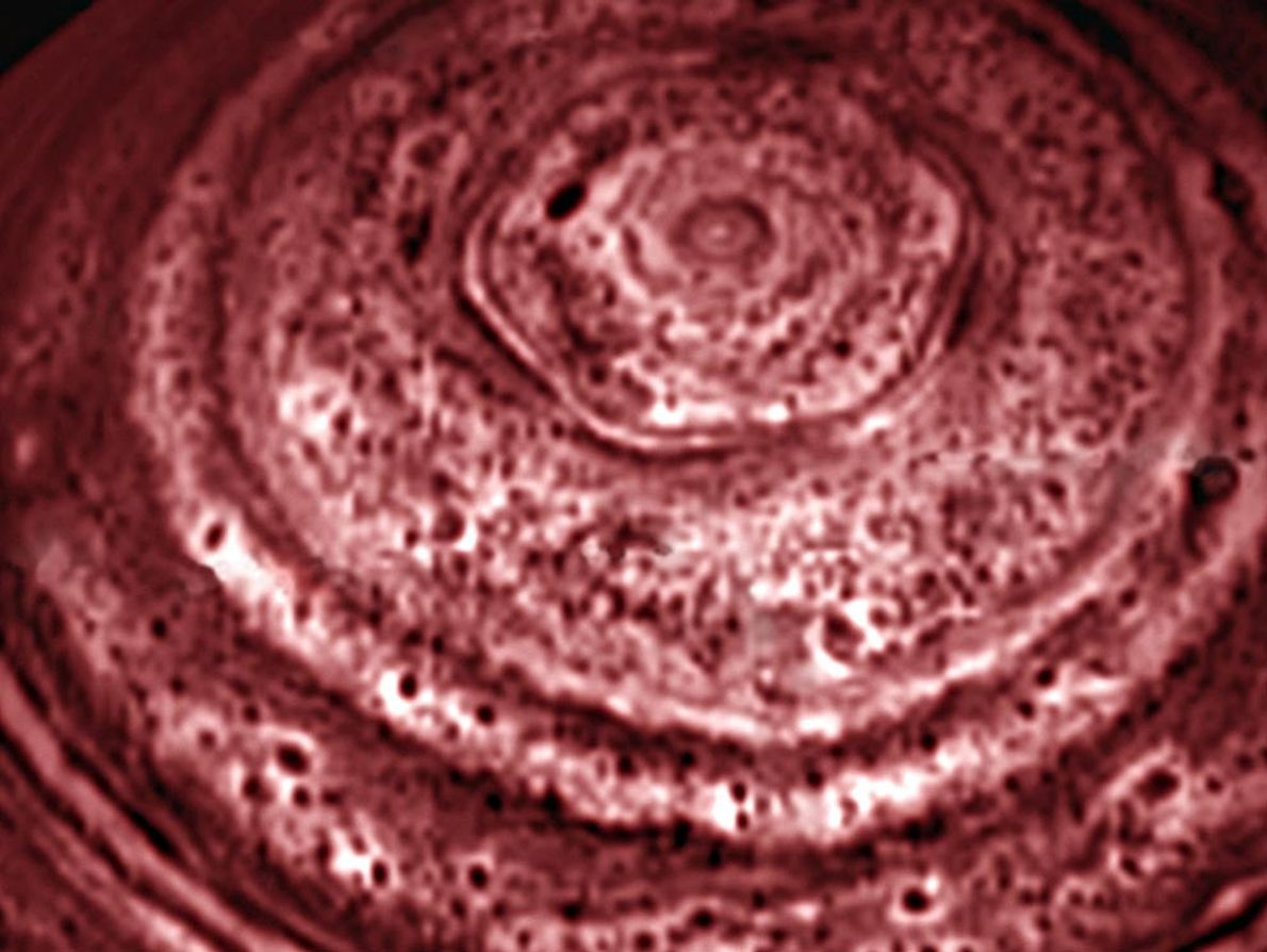 A six-sided feature encircles Saturn's north pole in this 2006 image. The hexagon was first observed ...
