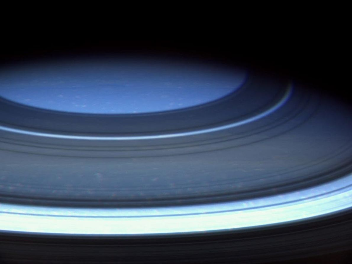 Saturn's northern hemisphere appears blue in this natural-color photograph taken by Cassini in December 2004. During ...