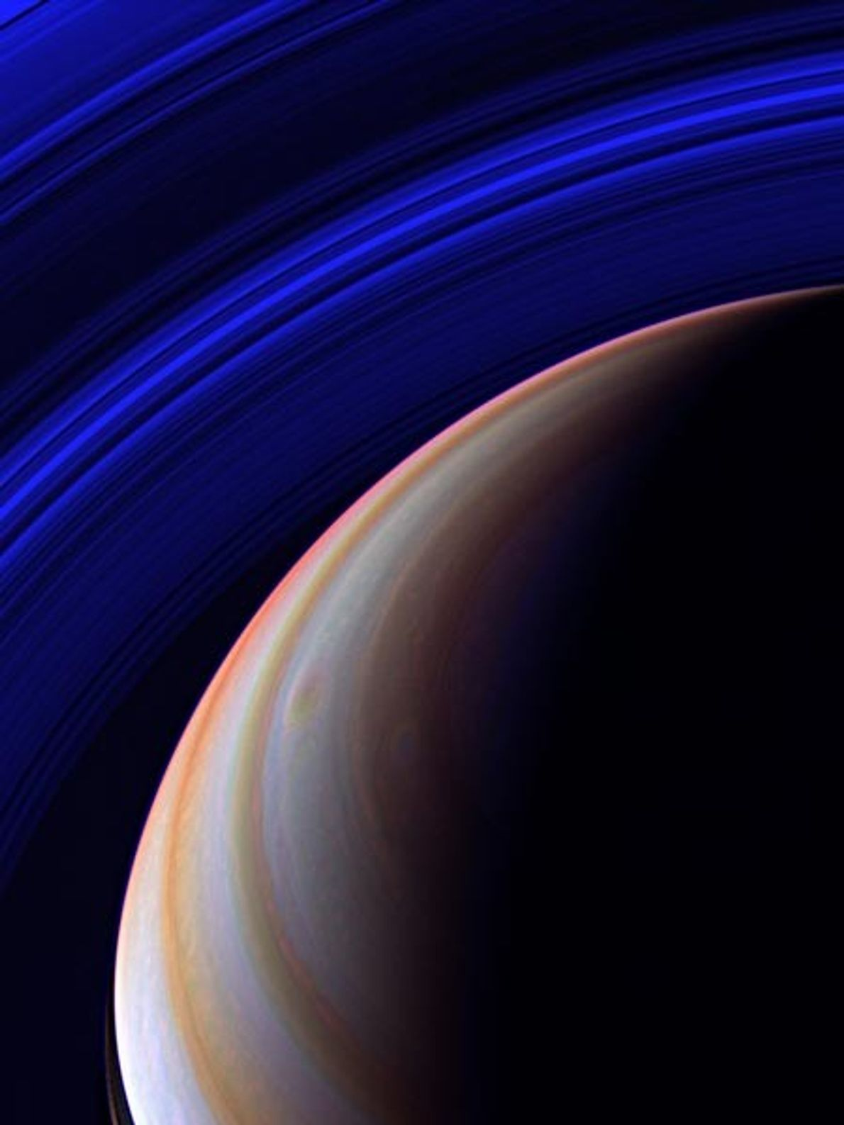 The Cassini spacecraft surveys Saturn's outstretched ring system in infrared from a vantage point high above ...