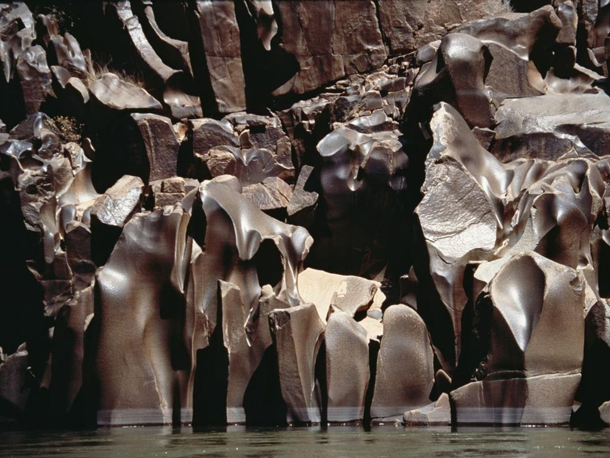 The Colorado River has eroded these schist formations into fudge-like shapes and shades. Schist, a metamorphic ...