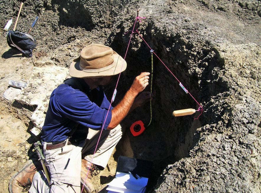 Study leader Robert DePalma conducts field research at the Tanis site.