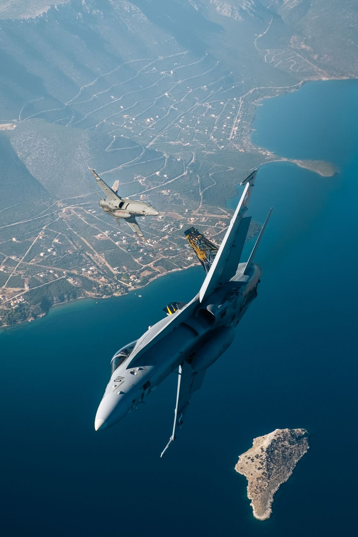 Your Shot photographer Giel Sweertvaegher captured this scene of a pair of Swiss F-18 jets as ...