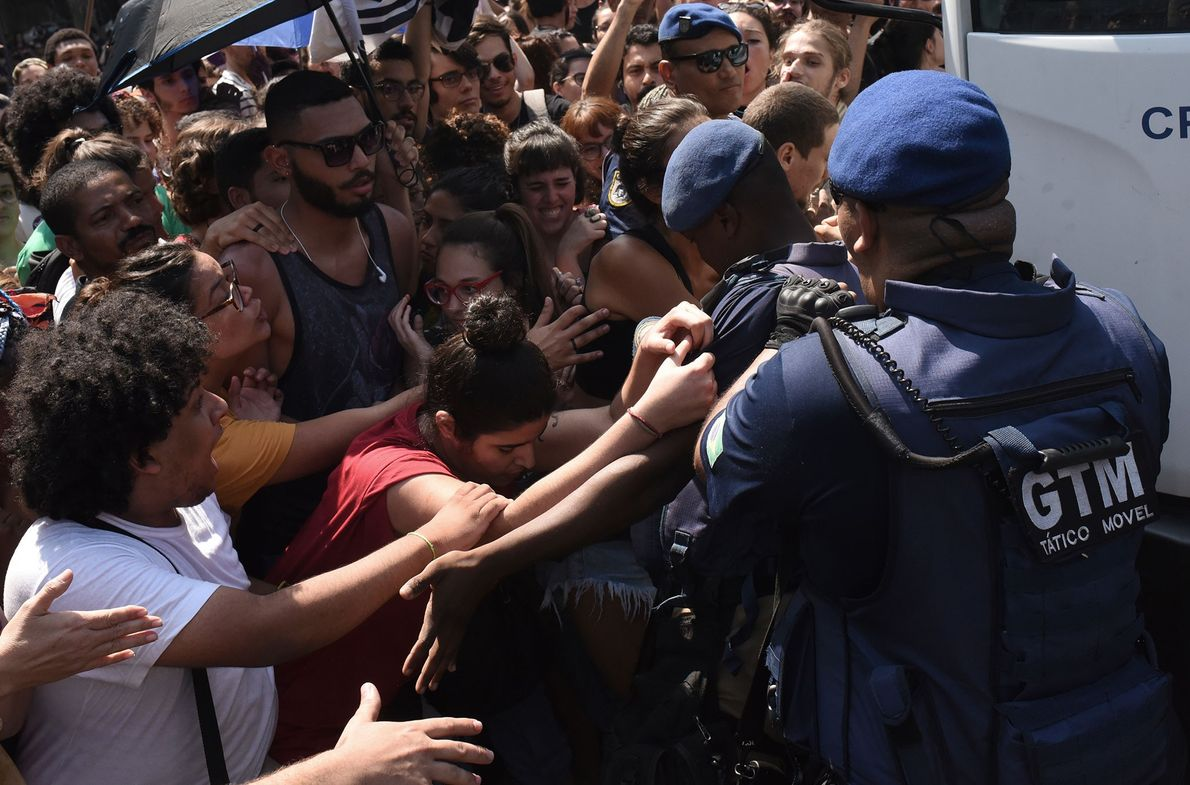 Students protest in front of the National Museum. Protests broke out across Rio de Janeiro in ...