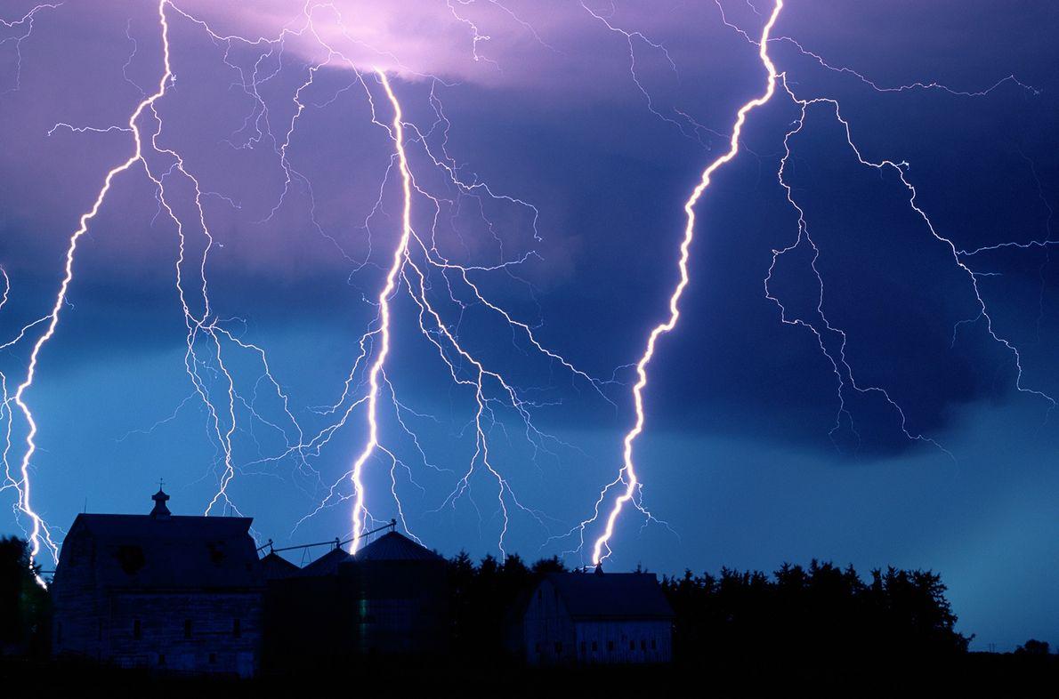 Streaks of lightning trace their way across the night sky.