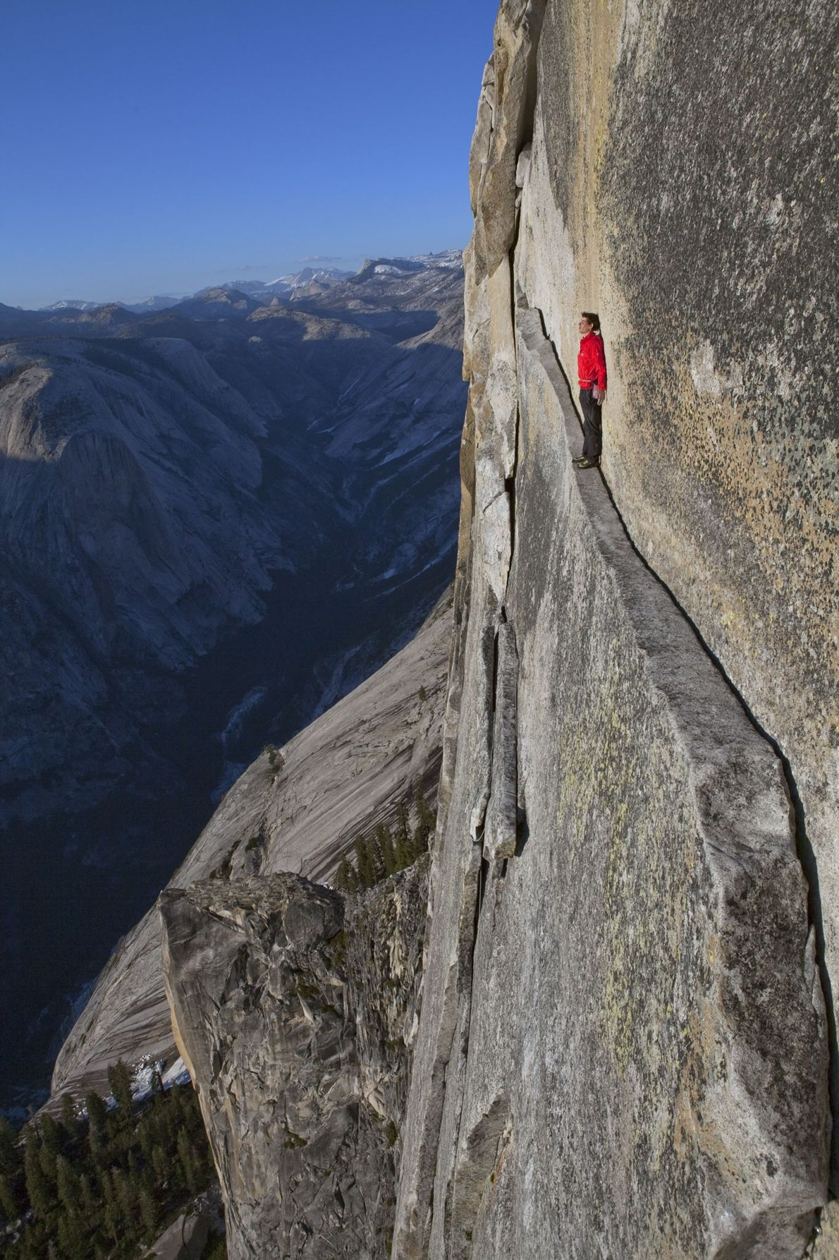 Rock climber, Alex Honnold, famous for his climbs without ropes or harnesses, walks a 13-metre (40-foot)-long ...