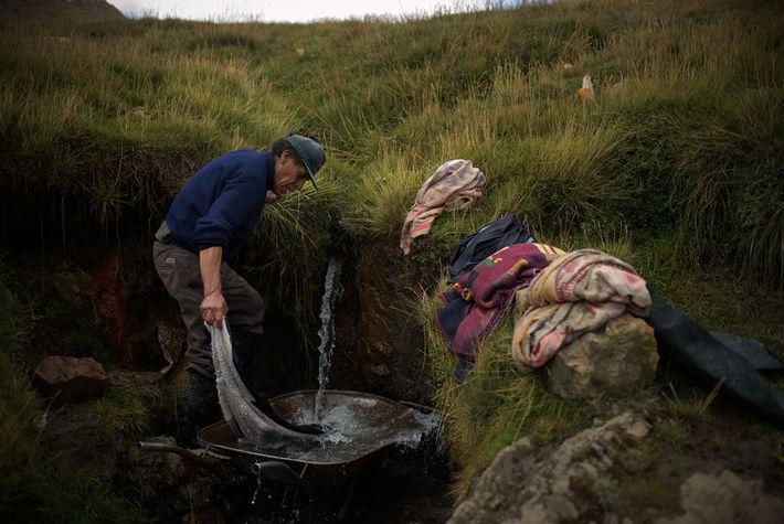 Hilario Mallqui Palacio washes clothes in a small stream on the outskirts of Cerro de Pasco. ...