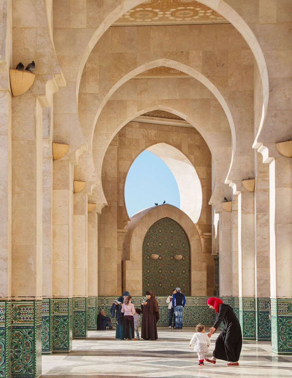 In Morocco visitors stroll through the Hassan II Mosque, one of the largest mosques in the ...