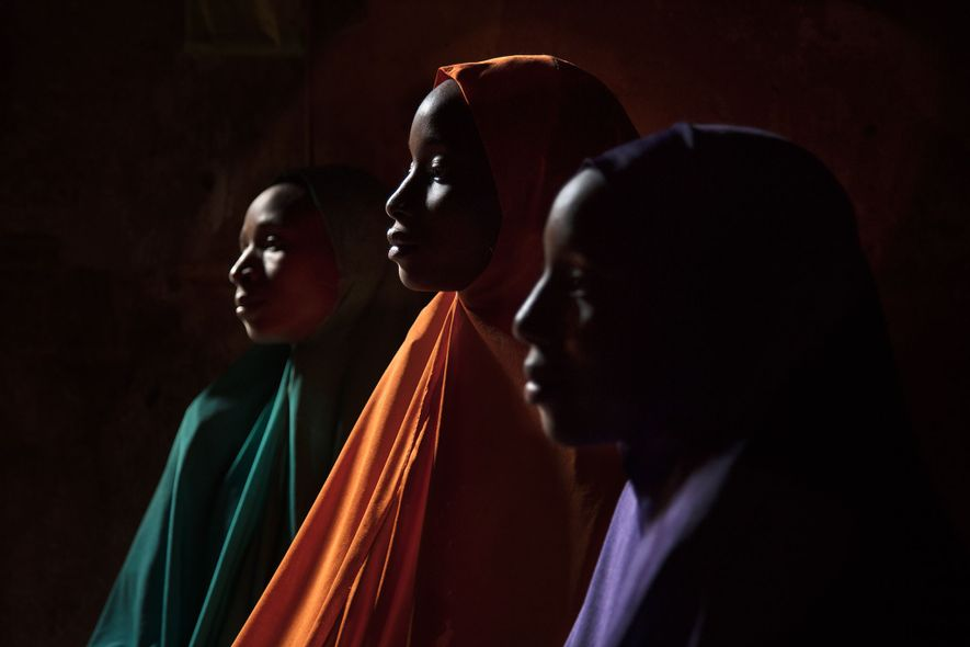 Ya Kaka is pictured here with her sisters Yagana, 21 (left), and Falimata, 14 (right). All ...