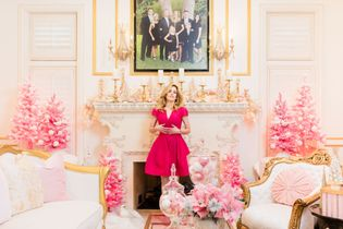 Homeowner, Jennifer Houghton poses below her family's portrait in the whimsical Winter Wonderland that is her ...