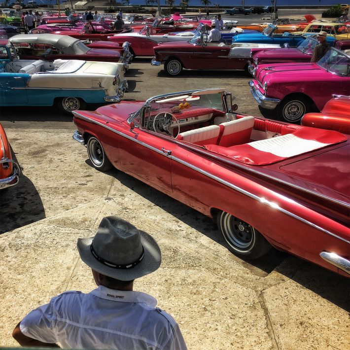 Classic cars are lined up to take models to a Chanel fashion show in Havana.