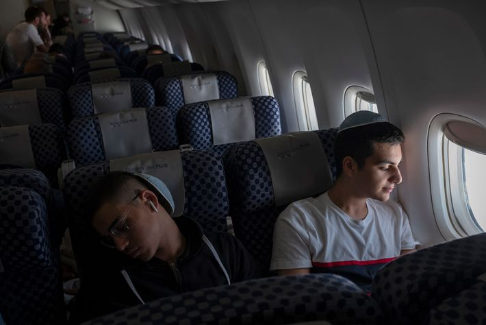 Brothers Gabriel and Netanel Zeitoun rest on their flight from Paris to Tel Aviv.