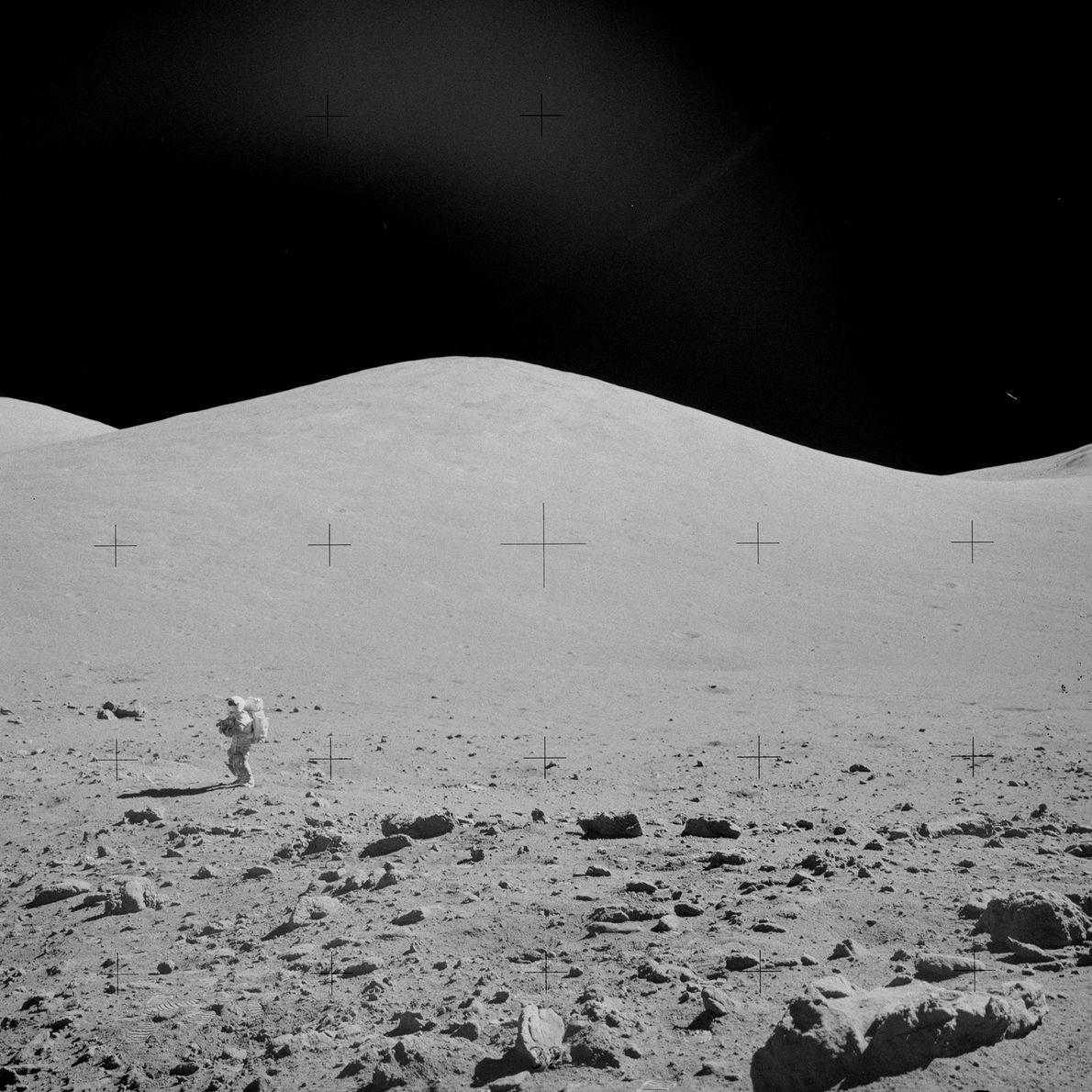 Gene Cernan, the commander of Apollo 17, walks on the lunar surface near the Van Serg ...