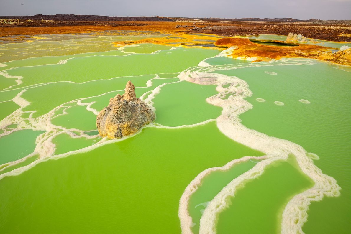 The Dallol hot spring in Ethiopia precipitates in white and gray, then to yellow, and finally ...