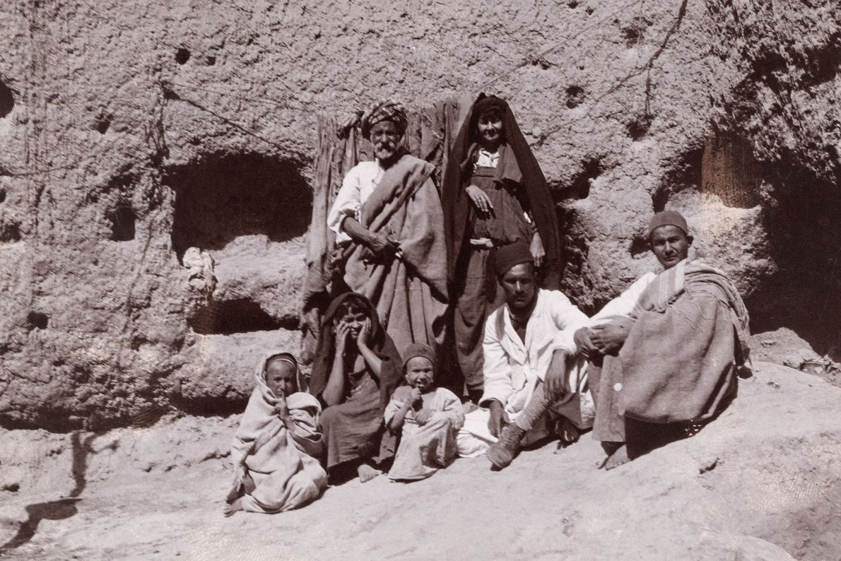 A family poses near the cave where animals are kept in Matmata.