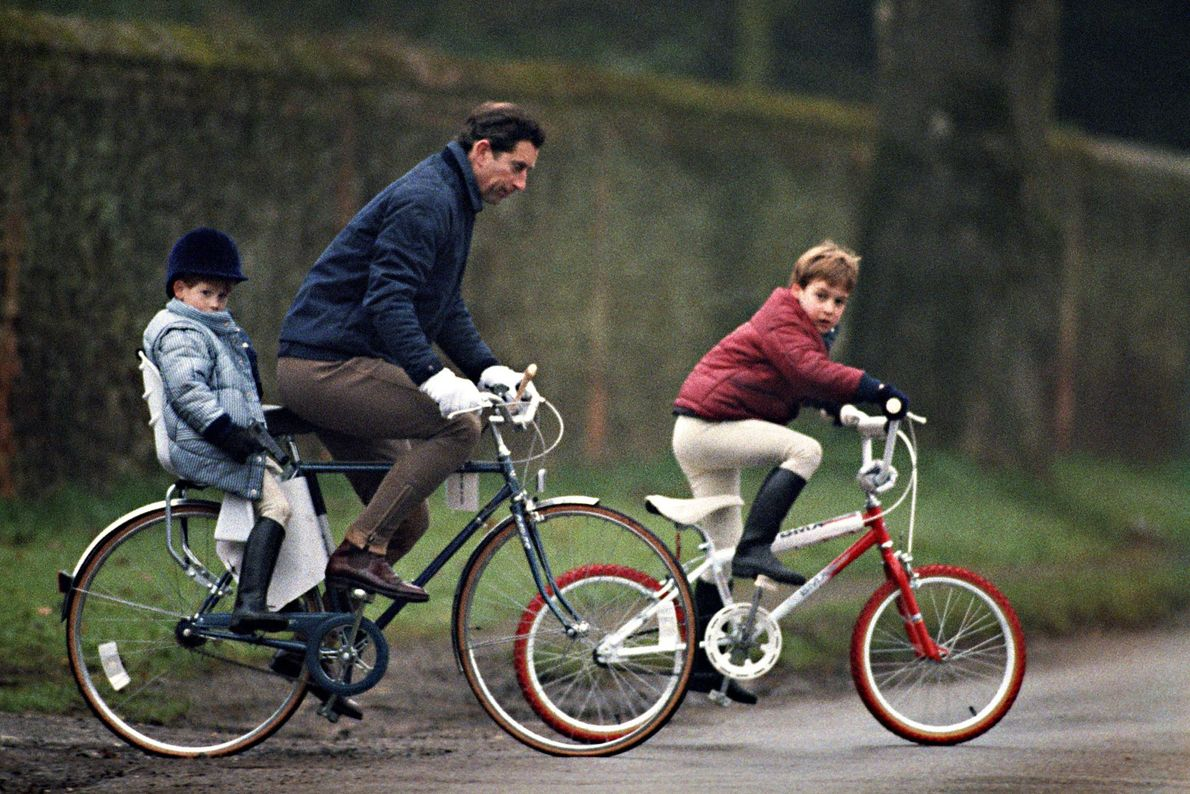 Prince Charles and his sons Prince William and Prince Harry cycle to the stables at Sandringham ...