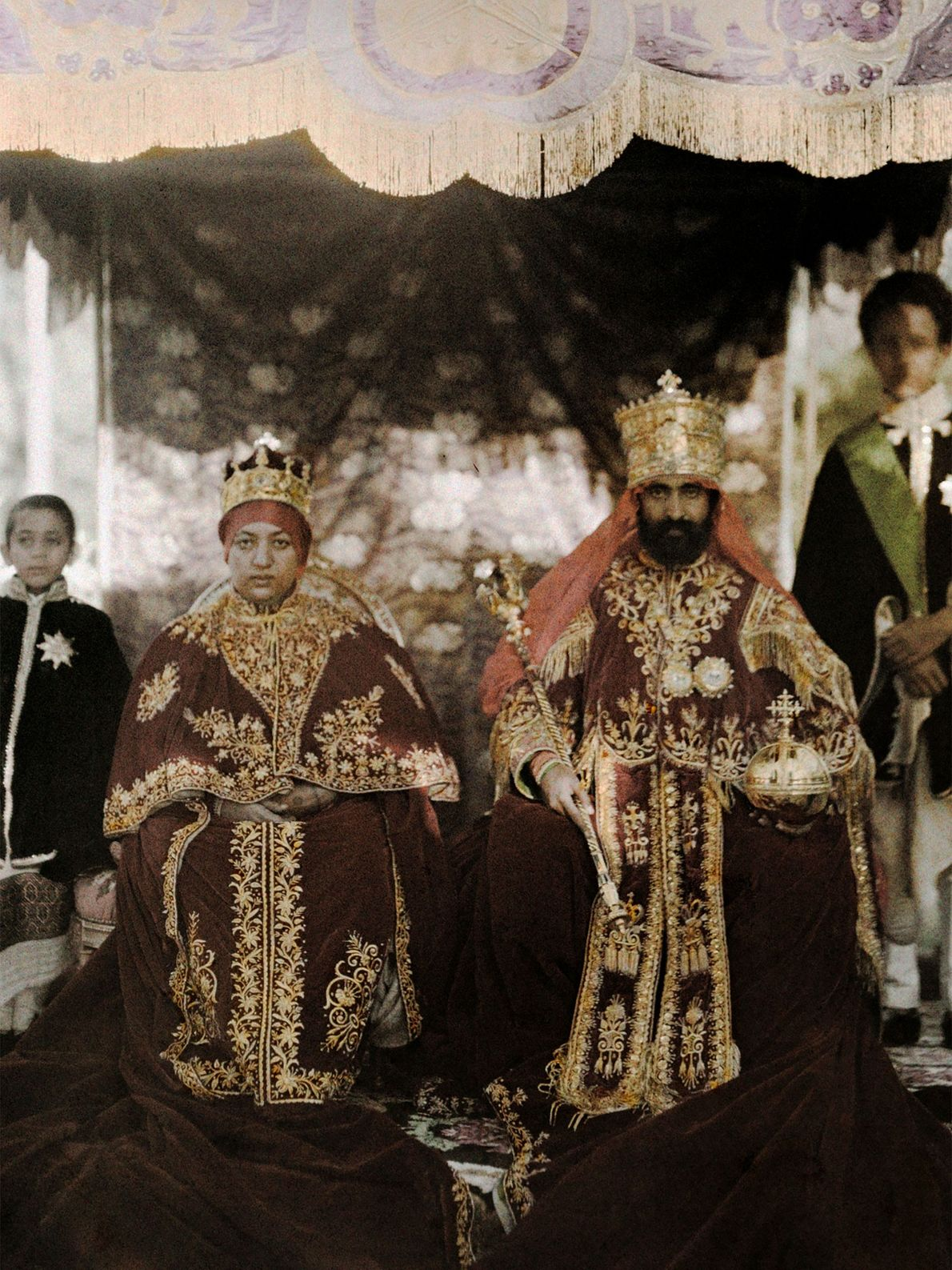 Emperor Haile Selassie I and Empress Menen Asfaw pose in their robes in Ethiopia. Haile Selassie's ...