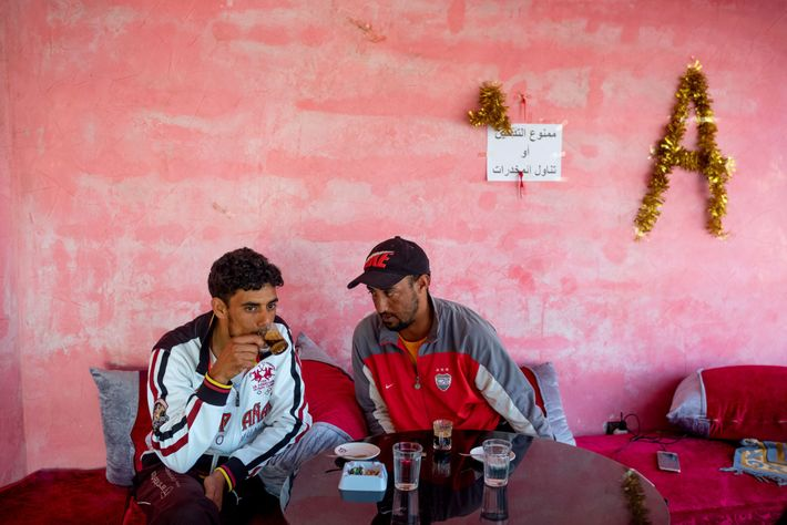 After the day's dive, Ibrahim Morsli (left) meets another fisherman over coffee. The café owner, Ahmed ...