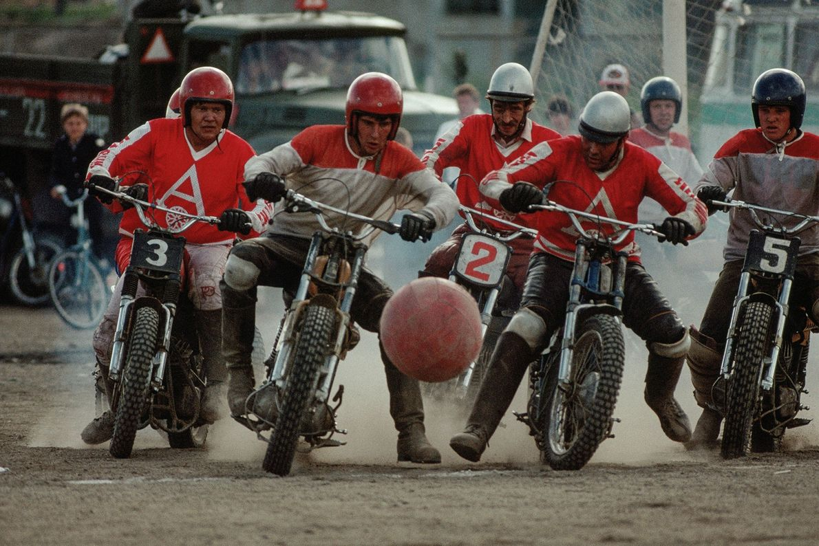In Siberia, Russia, a group of men on motorcycles play a game of motoball, a sport ...