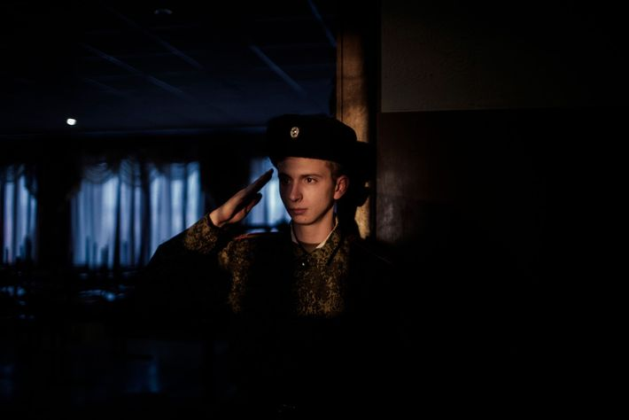 A young cadet salutes his superior at the G.T. Beregovoj  Military Lyceum in Donetsk. Since ...