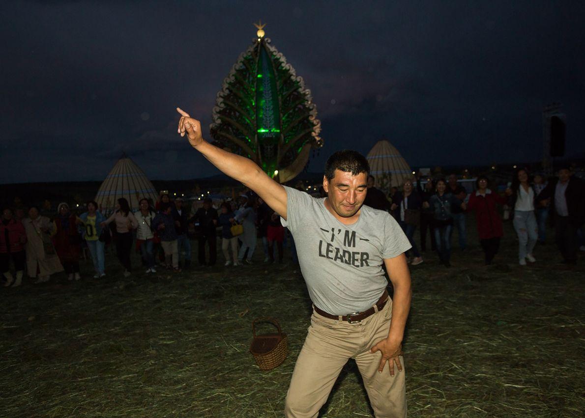 Ysyakh is a two-day festival. In Aldan, a festival goer dances during a night disco in ...