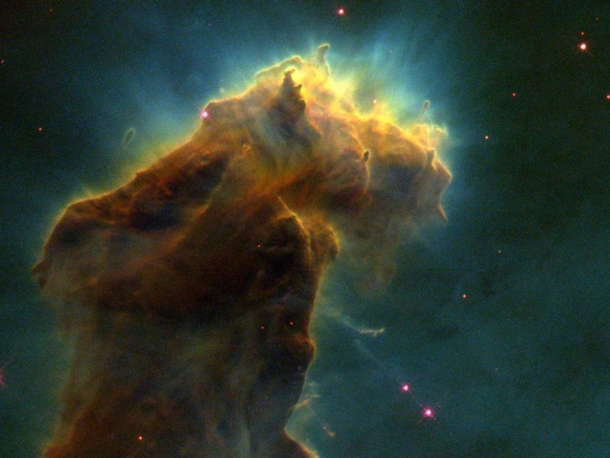 Pillars of hydrogen gas and dust streaming from the Eagle nebula give birth to new stars. ...