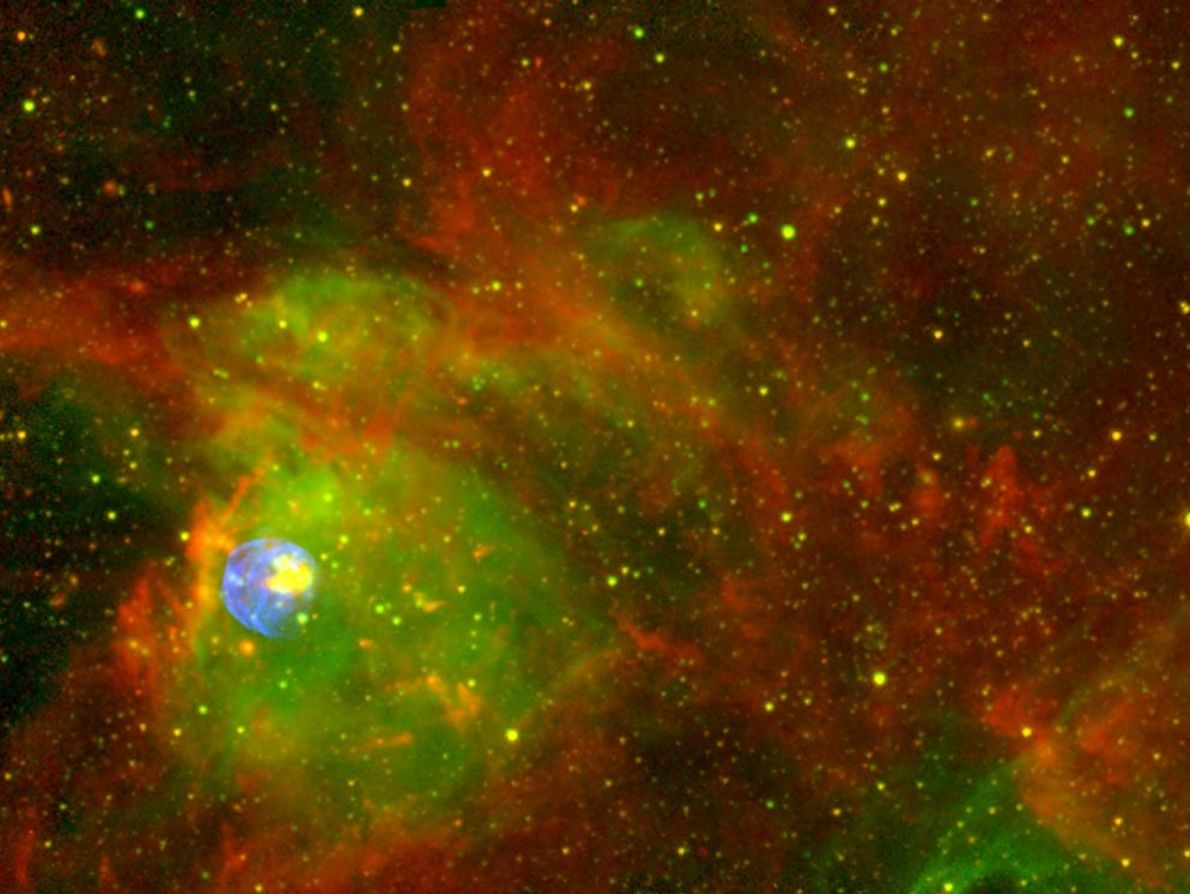 A violent and fiery-looking mass of gas and dust glows within a supernova remnant. The object, ...