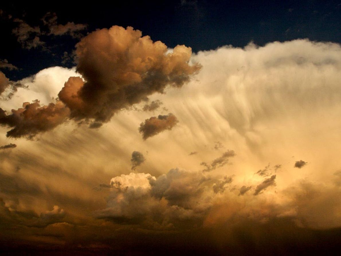 Cumulonimbus clouds, which are associated with severe storms, build in the skies above Mitchellton, Saskatchewan, Canada. ...