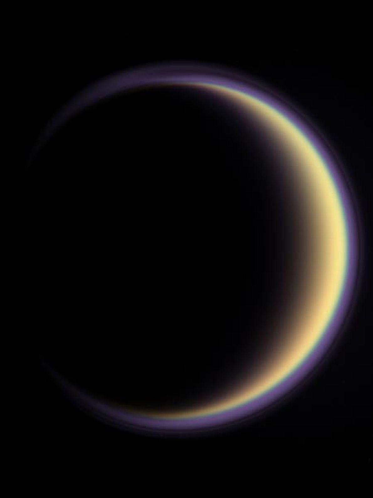 A halo surrounds Titan, Saturn's largest moon. Titan's atmosphere, almost entirely nitrogen, extends some 370 miles ...