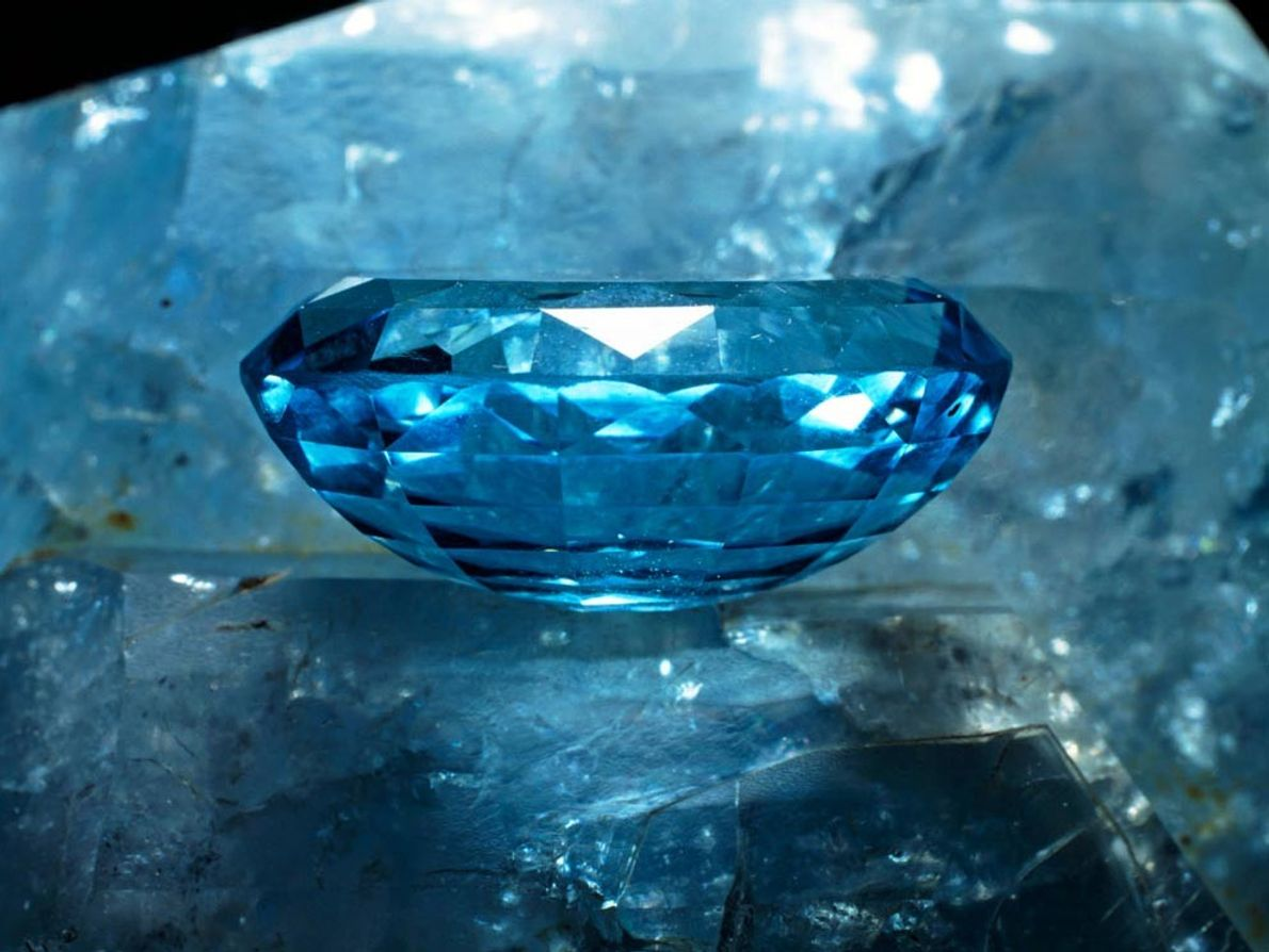 This cut topaz gemstone shows off its striking blue colouration, but the mineral also occurs in ...