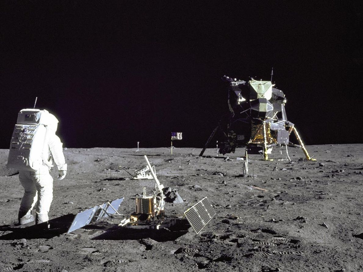 Astronaut Buzz Aldrin inspects equipment at Tranquility Base during Apollo 11's July 20, 1969, mission. The ...