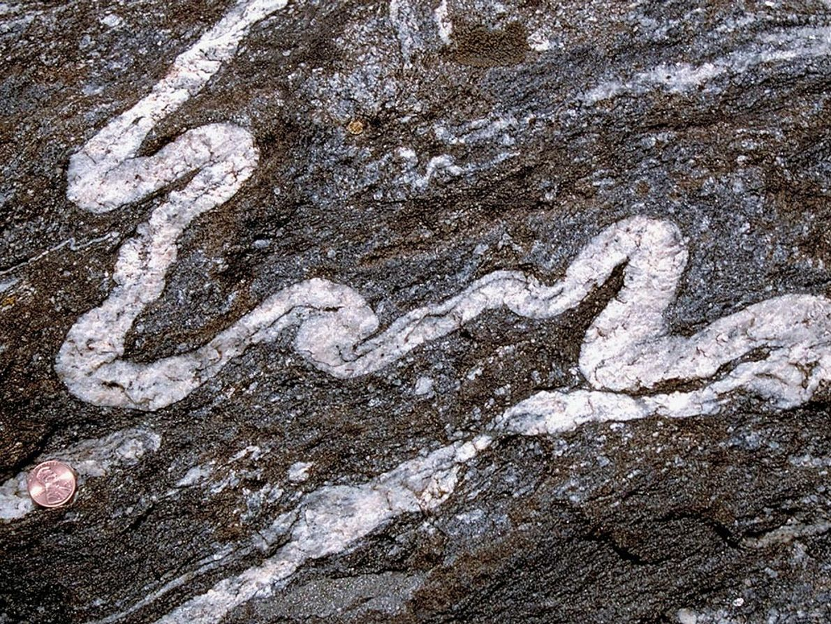 A river of white rock snakes within its darker surroundings, providing evidence that it had a ...