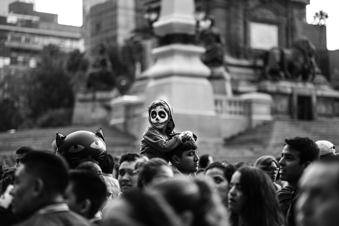 A young boy is framed amidst Day of the Dead celebrations in Mexico City.