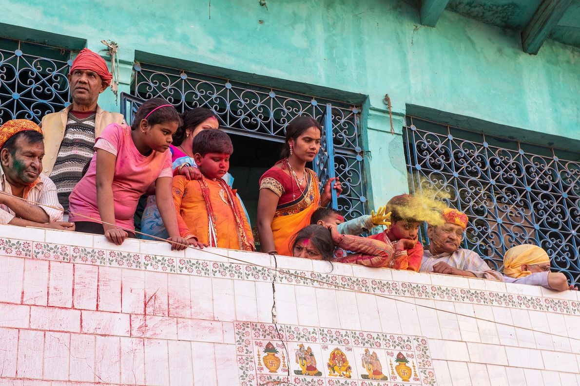 Some families prefer to participate as spectators from the safety of their balconies, avoiding the streets ...