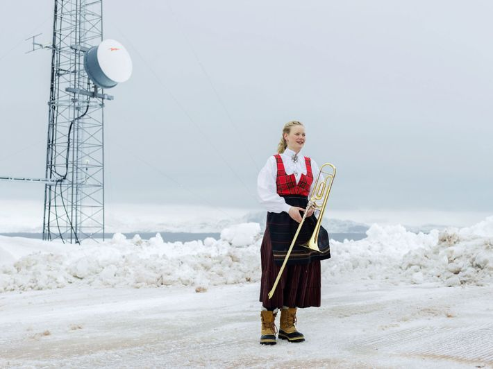 A woman takes a break from celebrations of Norway's Independence Day—May 17—at the base.