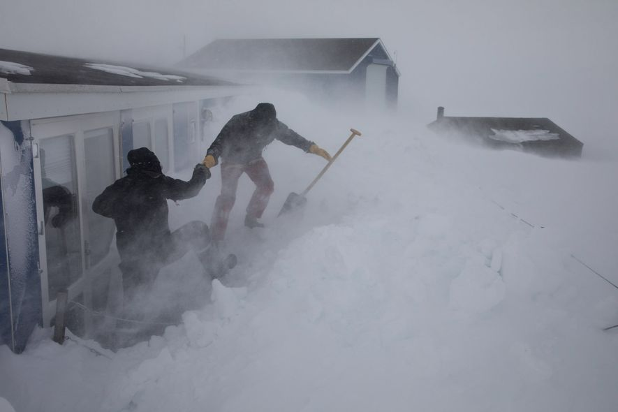 At their station in Daneborg, scientists must remove snow several times a day to access the ...