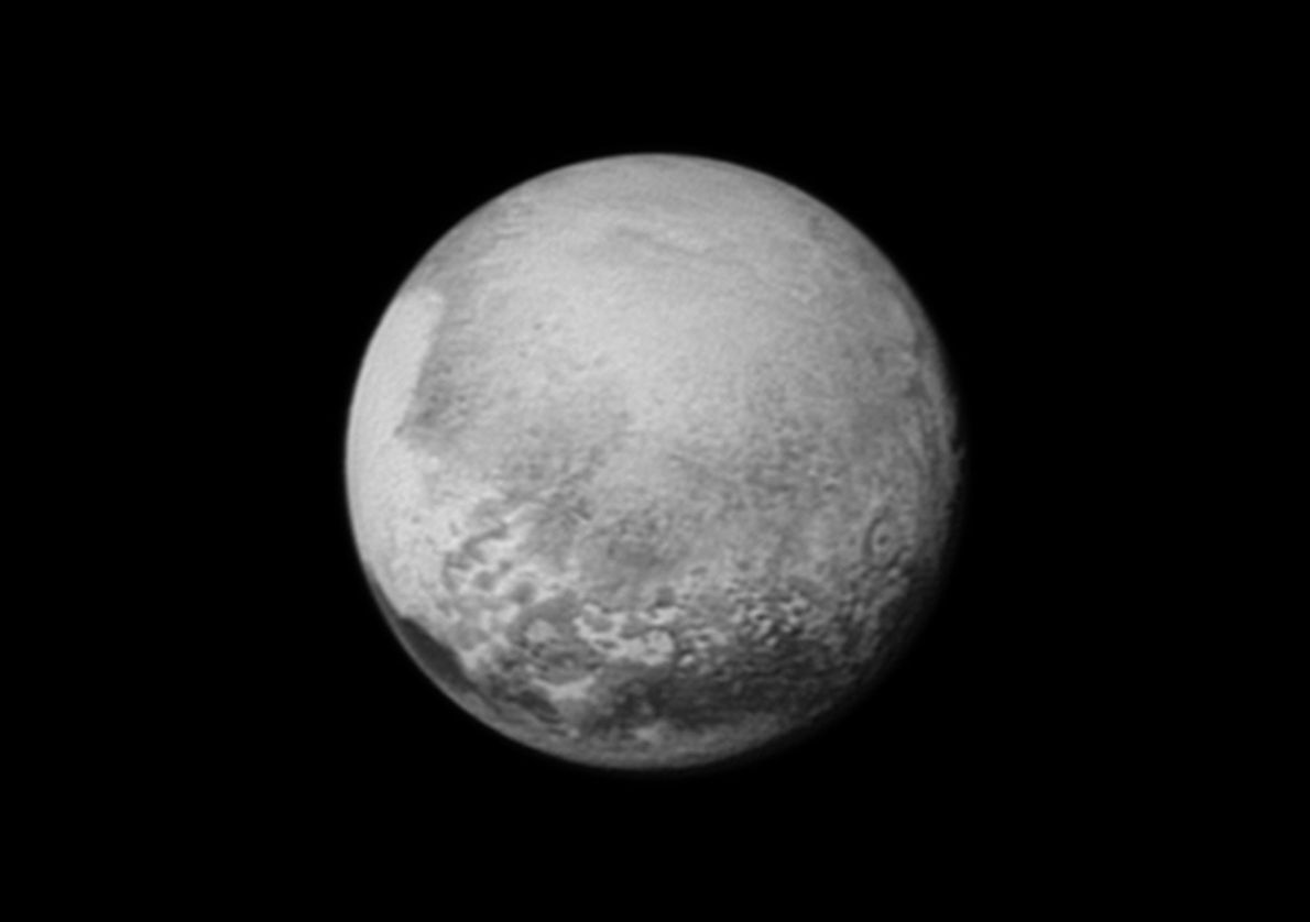 Pluto's bright heart-shaped plain is rotating into view on the left in this view from New ...