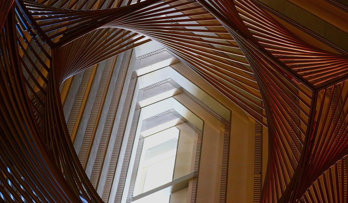 The lines of an intricate sculpture combine with the floors of the Hyatt Regency San Francisco ...