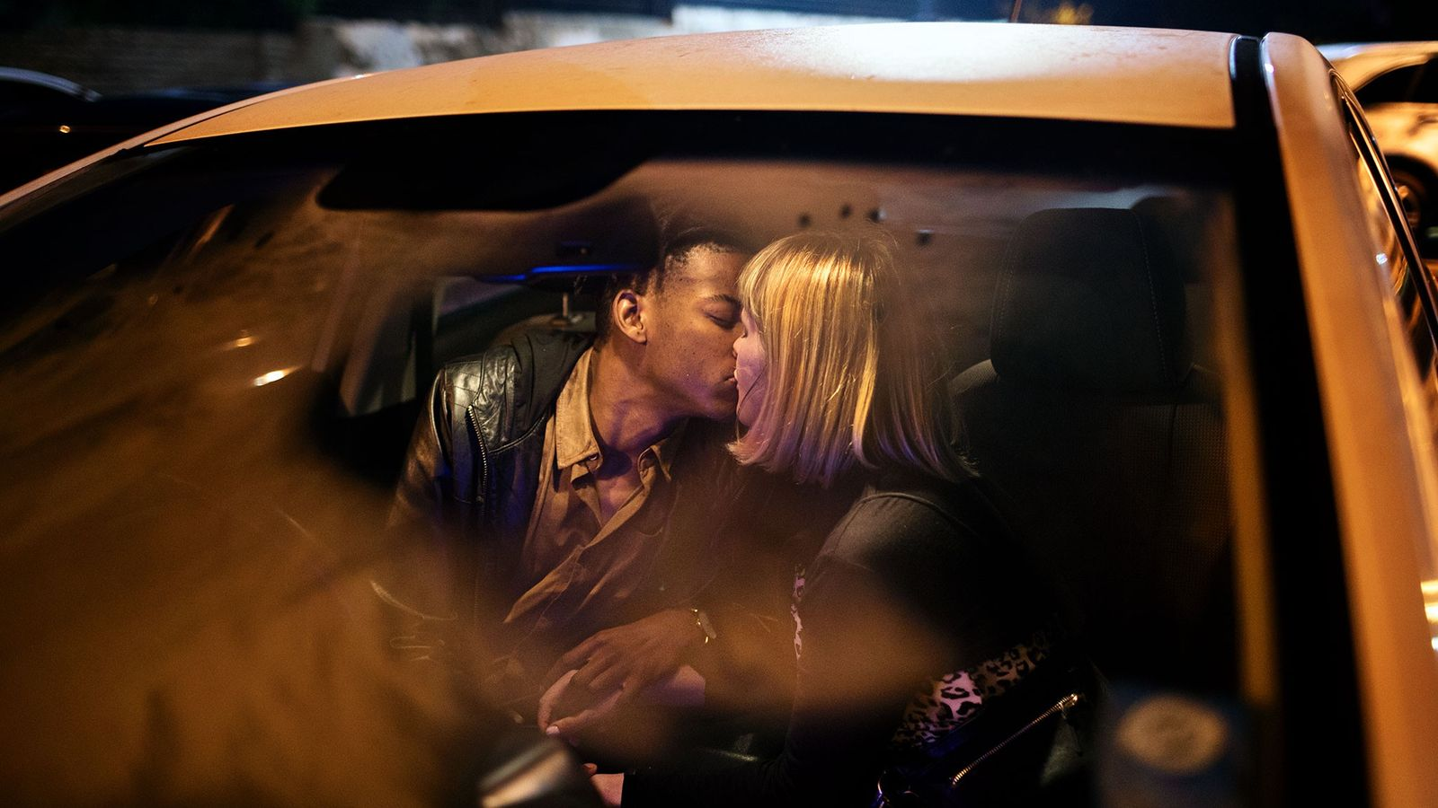 Wilmarie Deetlefs, 24, kisses her boyfriend Zakithi Buthelezi, 27, on a night out in Johannesburg. The ...