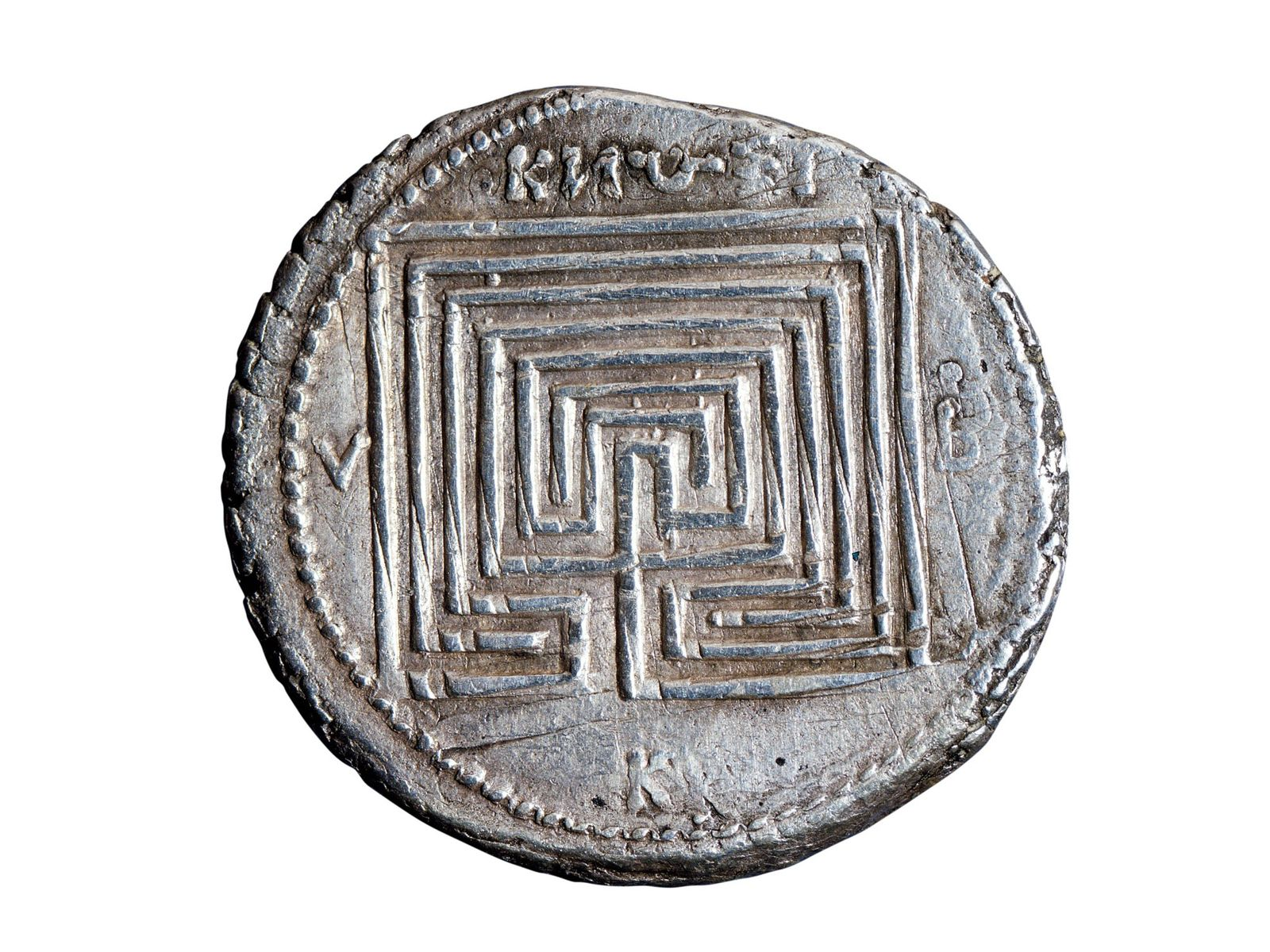 A fifth-century B.C. coin from Crete depicts the mythical Labyrinth. National Roman Museum, Rome