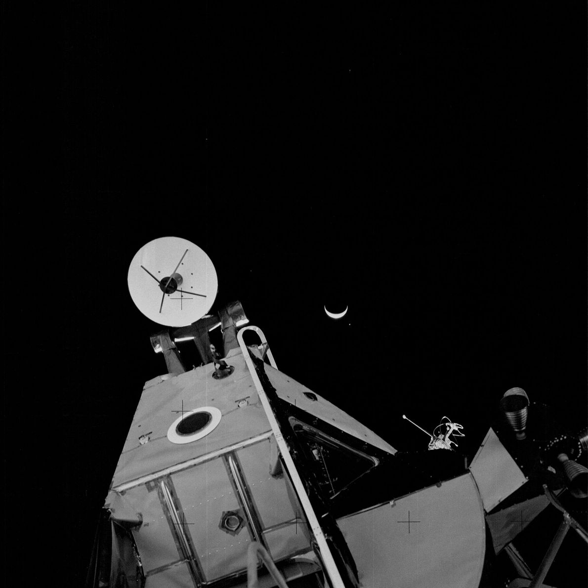Earth, partially obscured in shadow, behind Apollo 14's lunar module.