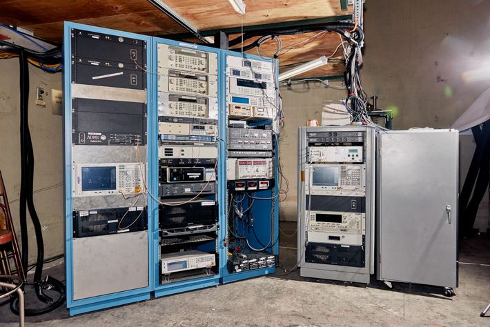 A bank of computers bristles with wires at the ADMX lab.
