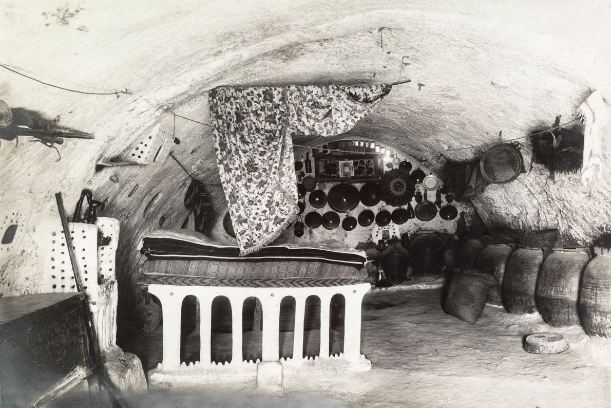 A bed occupies pride of place in a sheikh's underground home in Matmata.