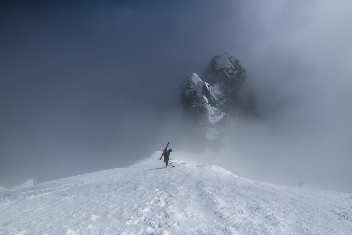 """""""Distant view of single adventurous mountain climber with skis climbing up Vysoka mountain in winter (High ..."""