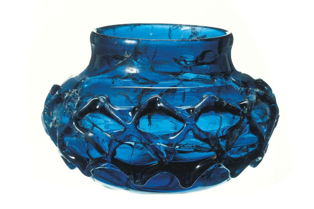 One of two rare, 1,400-year-old blue glass decorated beakers discovered intact within the Prittlewell burial.