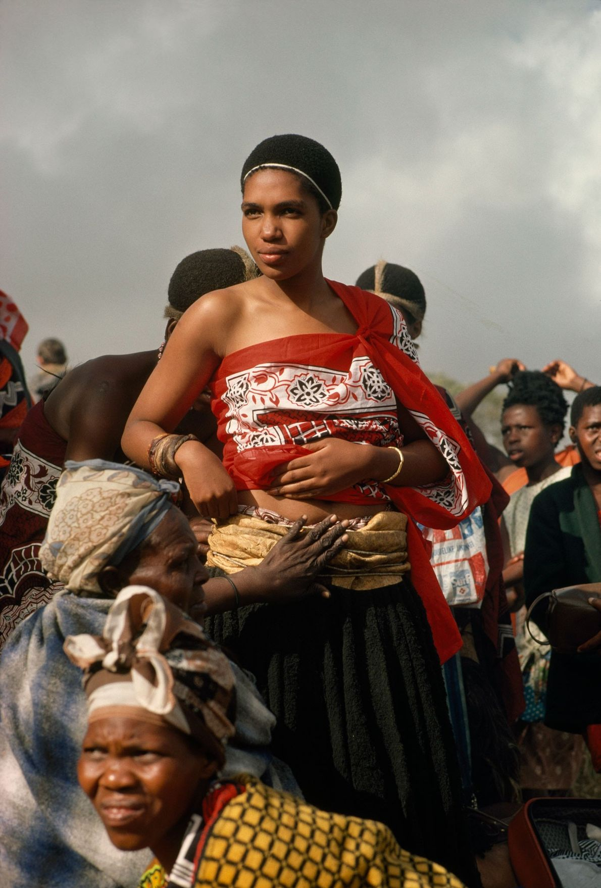 On her wedding day, a Swazi princess is dressed by older women in her town of ...