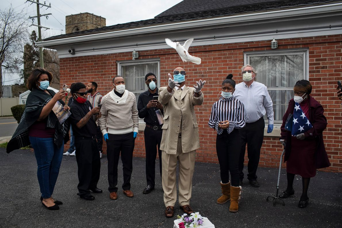 Jerry Lovett releases a dove after the funeral service for his brother, Chester Lovett, who died ...