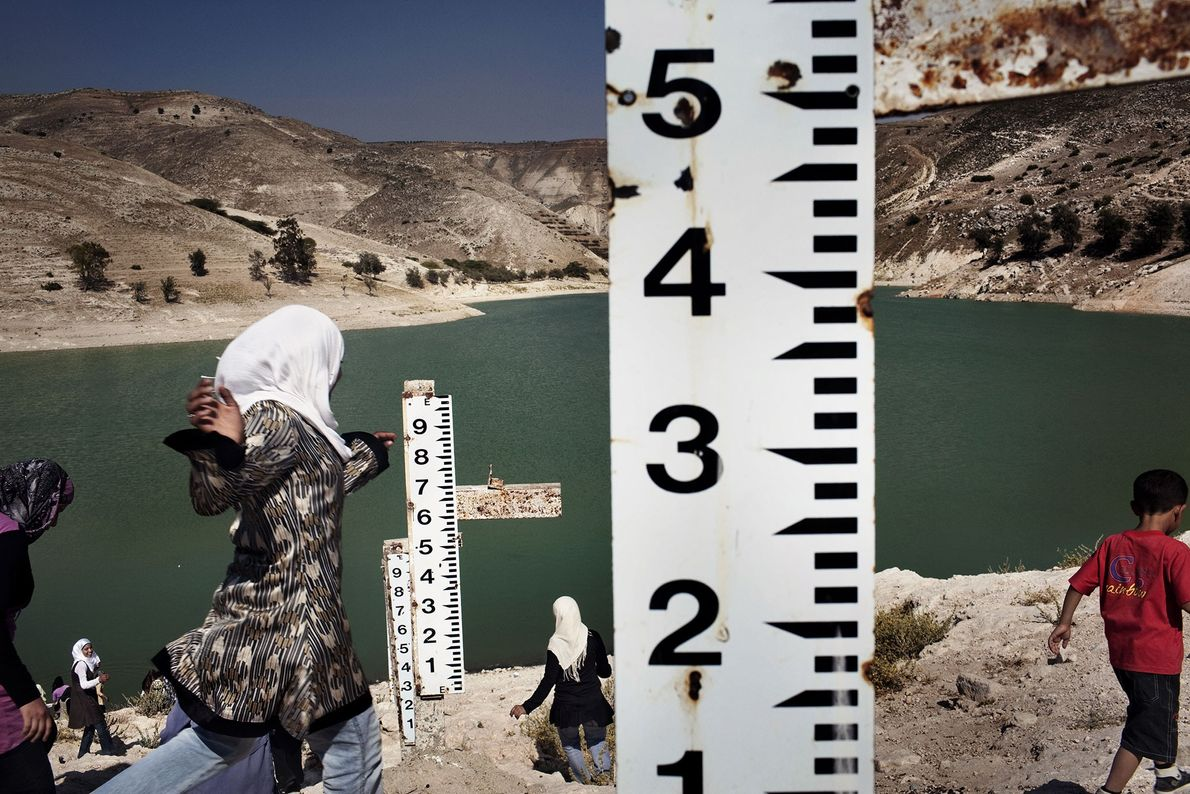 Ziglab Dam in Jordan has seen six years of drought. Measuring sticks record how much water ...