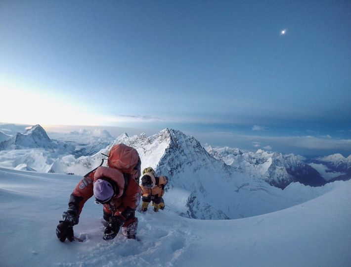 Nims Purja approaching the summit of Everest, with Lhotse (right) and Makalu (left) beyond.